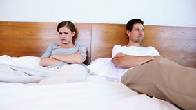 Unhappy couple not talking after argument. At home in bedroom stock video footage