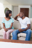 Unhappy couple not talking after argument on sofa Stock Photo