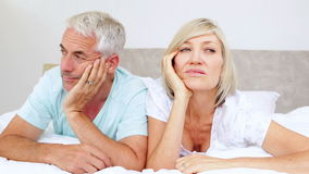 Unhappy couple not talking on bed stock footage