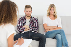 Unhappy couple not talking on the couch Stock Image