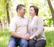 Unhappy couple in the park Stock Images