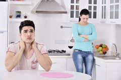 Unhappy couple red vine in the kitchen Stock Photos