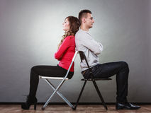 Unhappy couple sitting back to back. Disagreement. Royalty Free Stock Photography