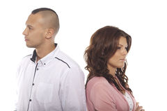 Unhappy Couple Standing Back To Back royalty free stock photography