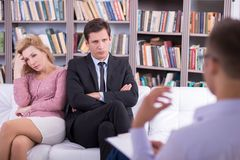 Unhappy couple talking to the psychologist and Royalty Free Stock Photography