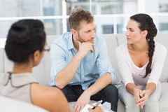 Unhappy couple at therapy session Stock Photo