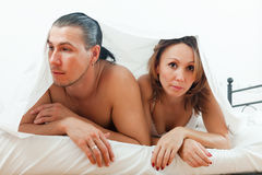 Unhappy couple under sheet Royalty Free Stock Images