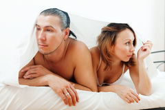 Unhappy couple under sheet Stock Images