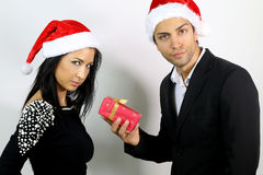 Unhappy couples for a gift at Christmas. Unhappy young couples for a gift at Christmas stock photos