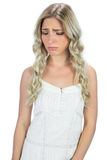 Unhappy curly haired blonde posing Stock Photography