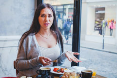 Unhappy customer in restaurant, angry woman. Complaining about food and service in cafe Royalty Free Stock Image