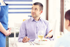 Unhappy customer in a restaurant Royalty Free Stock Photography