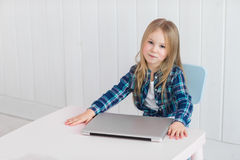 Unhappy cute female child using notebook pc royalty free stock photos