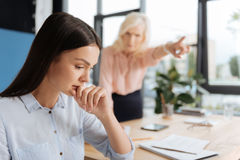 Unhappy depressed woman being fired. Worst day of my life. Unhappy depressed young women sitting at her chiefs office and thinking about her future wile being Stock Image