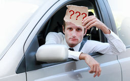 Unhappy driver in his car asking for help. Traffic, stress and transportation concepts stock images