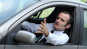 Unhappy driver in his car. Traffic and transportation concepts, road rage theme royalty free stock image