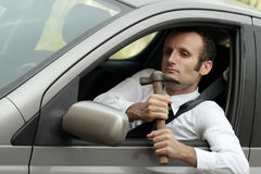 Unhappy driver in his car. Traffic and transportation issues concepts stock images