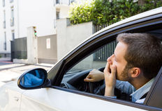 Unhappy driver in his car. Traffic and transportation issues concepts royalty free stock photos