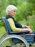Unhappy elderly woman Stock Photo
