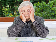 Unhappy elderly woman Royalty Free Stock Photos