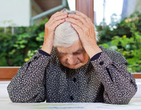 Unhappy elderly woman Royalty Free Stock Image