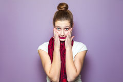 Unhappy emotional expression concept on purple background. Royalty Free Stock Image