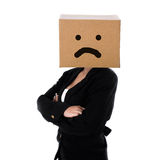 Unhappy face on box, business woman Royalty Free Stock Image