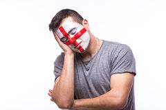 Unhappy and Failure of goal or lose game emotions of  Englishman football fan Stock Image