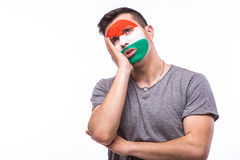 Unhappy and Failure of goal or lose game emotions of  Hungarian football fan in game supporting of Hungary national team Stock Photos