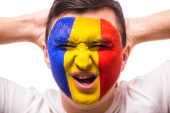 Unhappy and Failure of goal or lose game emotions of Romanian football fan in game supporting of Romania national team on grey bac Stock Images