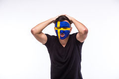 Unhappy and Failure of goal or lose game emotions of  Swede football fan Royalty Free Stock Photo