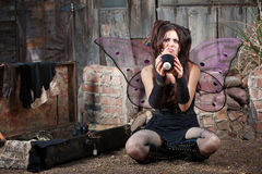 Unhappy Fairy With Eight Ball. Unhappy Caucasian fairy relaxing on ground with magic eight ball Royalty Free Stock Photos