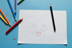 Unhappy family and child custody battle concept sketched on stic. Divorce and drawing a sad child Stock Images