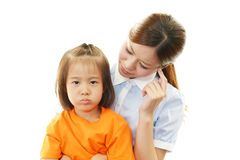 Unhappy family. Sad looking girl with her mother on a white background Royalty Free Stock Images