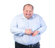 Unhappy Fat Man in a Blue Shirt. Isolated Stock Photo