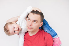 Unhappy father holding child at white background. Unhappy father with child. Stress. Baby. Sad daddy. Family problems. Paternal care very important for kid Royalty Free Stock Photos