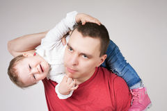 Unhappy father holding child at white background. Unhappy father with child. Stress. Baby. Sad daddy. Family problems. Paternal care very important for kid Royalty Free Stock Photo