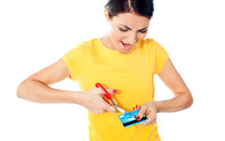 Unhappy female customer destroying her atm card Stock Photography
