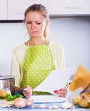 Unhappy female freelancer with papers Stock Images