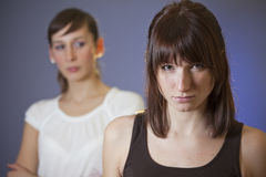 Unhappy female friends. Conflict between female friends - shot in studio Stock Photo