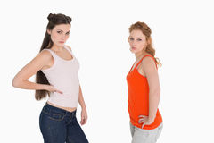 Unhappy female friends not talking after argument Stock Photos