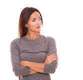 Unhappy female in grey blouse looking angry. While looking to her left in white background - copyspace Stock Photography
