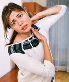 Unhappy female with neck and shoulders aching Royalty Free Stock Photos