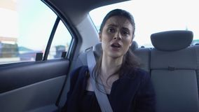 Unhappy female passenger telling amateur driver fastest route, poor service. Stock footage stock video footage