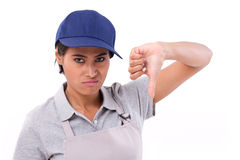 Unhappy female worker giving thumb down gesture Stock Photos