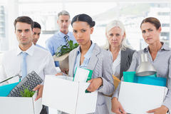 Unhappy fired business people holding box Royalty Free Stock Photo