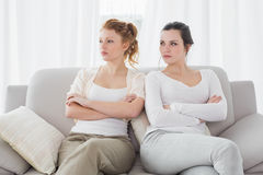 Unhappy friends not talking after argument on the couch Stock Image