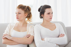 Unhappy friends not talking after argument on the couch Royalty Free Stock Images