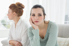 Unhappy friends not talking after argument on the couch Royalty Free Stock Photos
