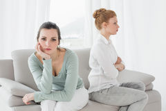 Unhappy friends not talking after argument on the couch Royalty Free Stock Image